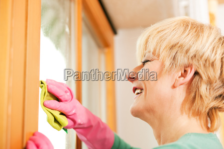 housewife is cleaning the window
