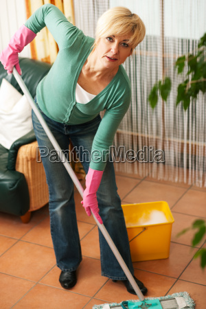 woman mopping the floor in the