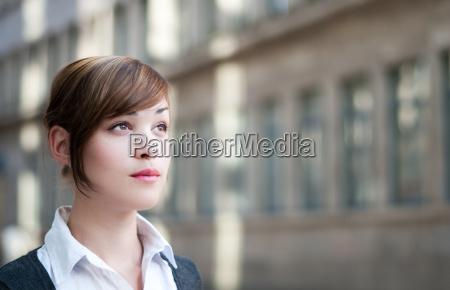 businesswoman looks into the future