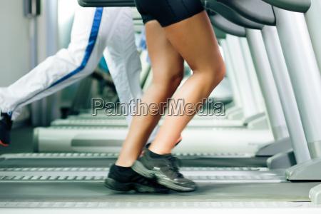 people running on treadmill in studio