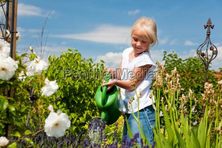 little girl pours flowers