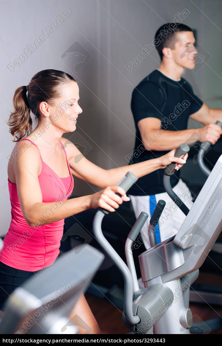 people, exercising, on, elliptical, machine - 3293443