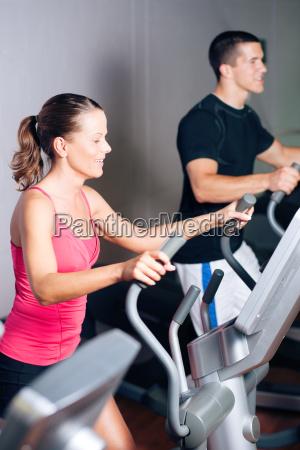 people, exercising, on, elliptical, machine - 3293443