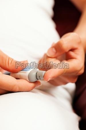 woman, making, test, for, diabetes - 3293555