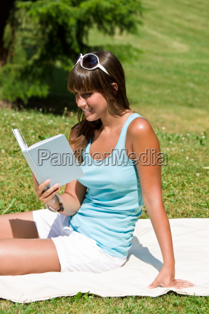 smiling young woman read book in