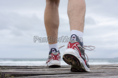 feet of a jogger on the