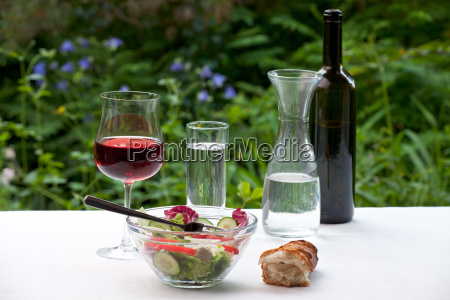 salad and wine outside in the