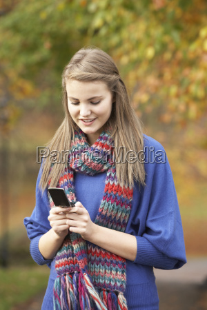 teenage girl making mobile phone call