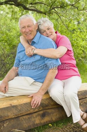senior couple sitting on bench