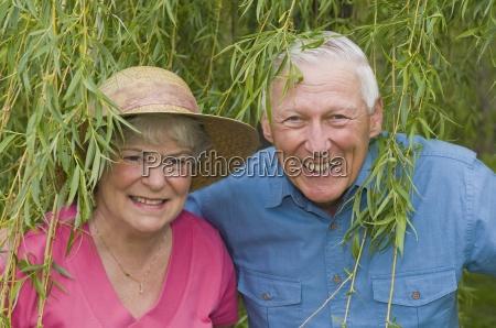 senior couple under willow tree