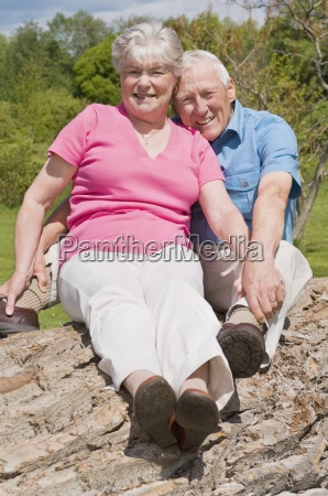 senior couple at park on fallen