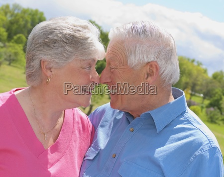 senior couple rubbing noses