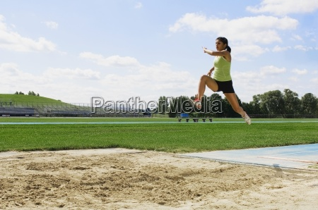 woman doing long jump