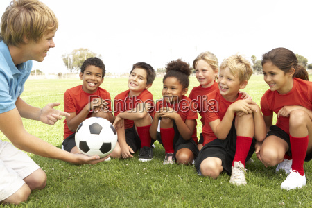 young boys and girls in football