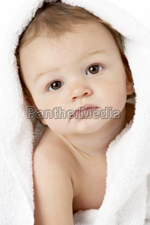 studio portrait of baby boy wrapped