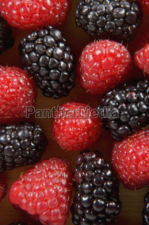 close up of blackberries and raspberries