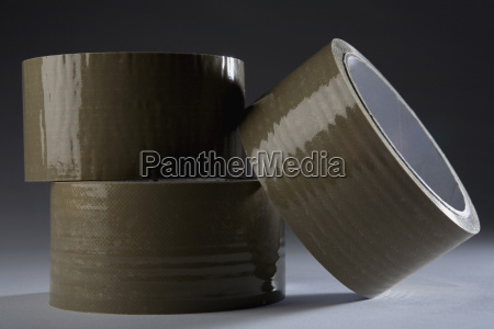 close up of three adhesive tapes