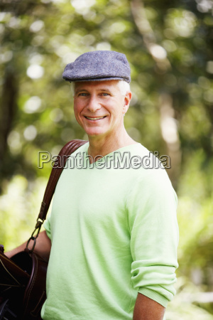 portrait of a mature man carrying