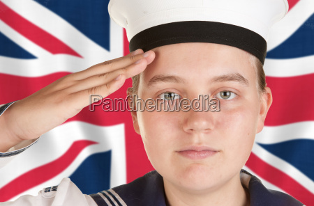 young sailor saluting in front of