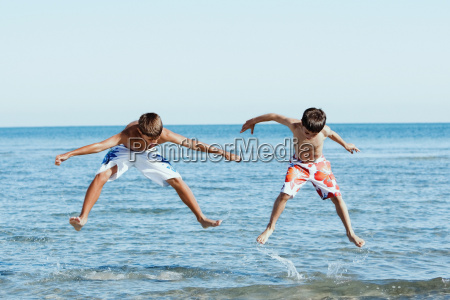 teenage boy jumping with his brother