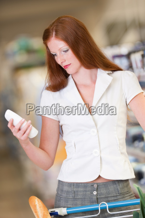 shopping beautiful woman hold shampoo