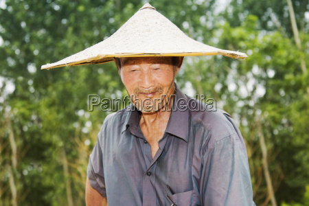 close up of a farmer wearing