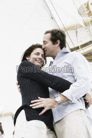 mid adult man kissing on forehead