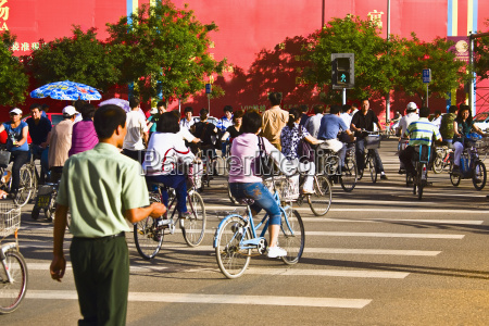 group of people riding bicycles hohhot
