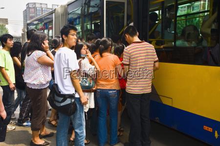 passengers boarding in a bus beijing