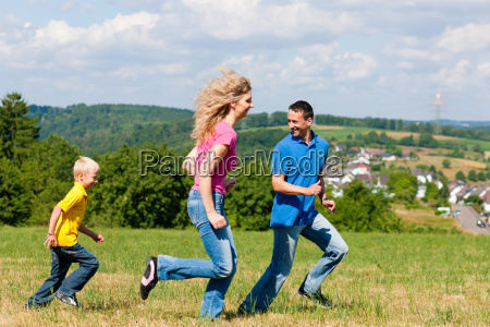 family is playing catch in the