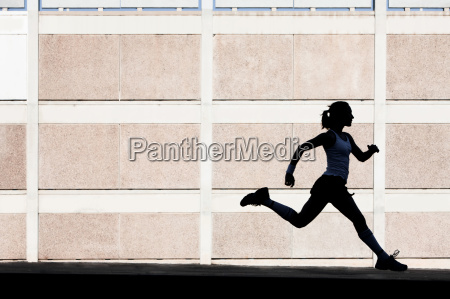 physically fit woman runs for exercise