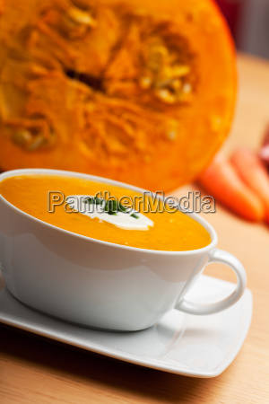 pumpkin soup in a white soup