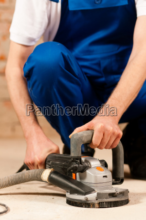 sanding the cement floor