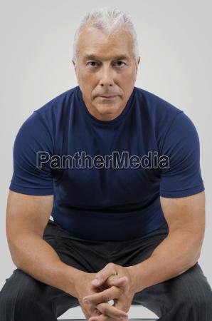 portrait of a senior man sitting
