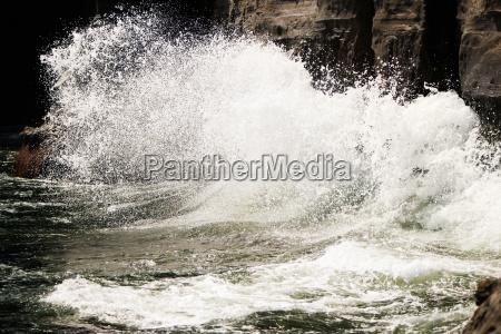 waves crashing against a rock la