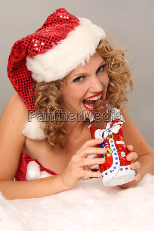 woman bites in santa claus