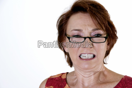 portrait of a senior woman clenching