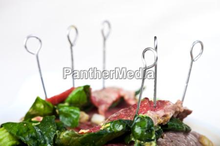 metal skewer in a raw roulade