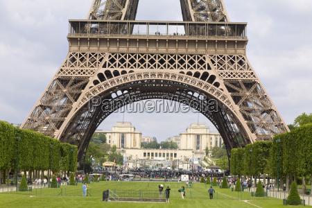 tourists near a tower eiffel tower