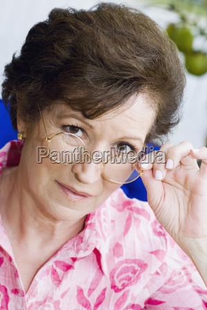 portrait of a senior woman peeking