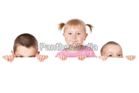 three child behind white board