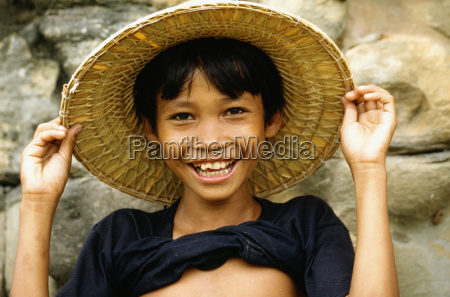portrait of a boy smiling and
