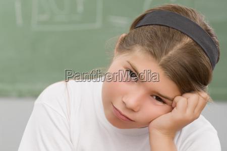 portrait of a schoolgirl thinking in