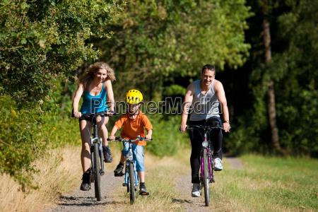 family rides a bike as a