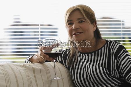 portrait of a senior woman holding