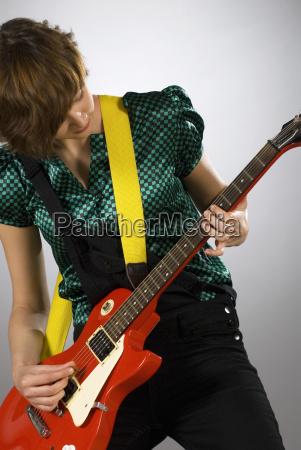 close up of a female guitarist