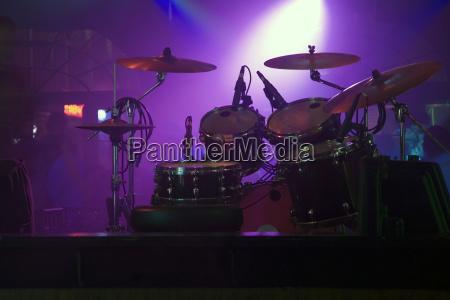 spotlight on a drum kit in