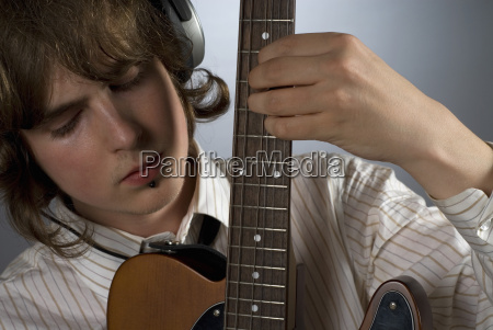 close up of a guitarist playing