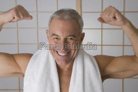 portrait of a senior man flexing