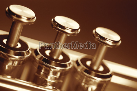extreme close up of trumpet keys